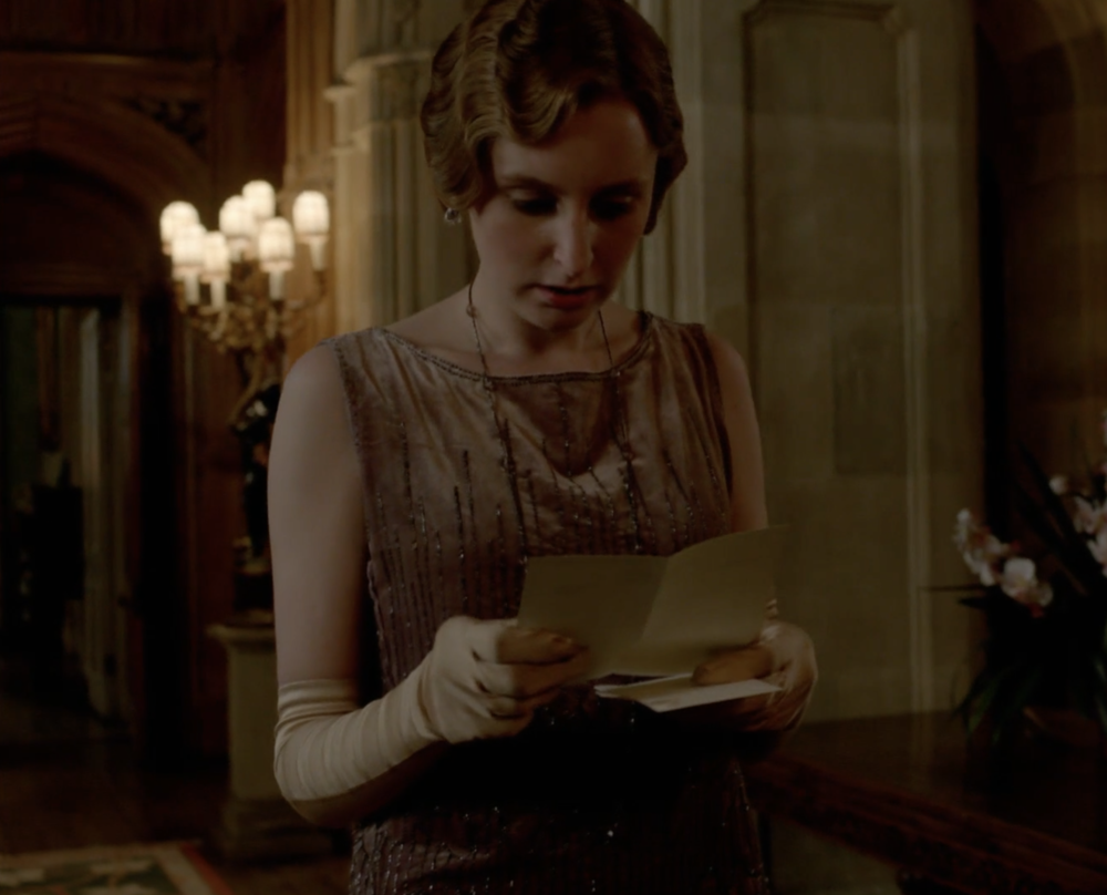 Edith reading a letter.