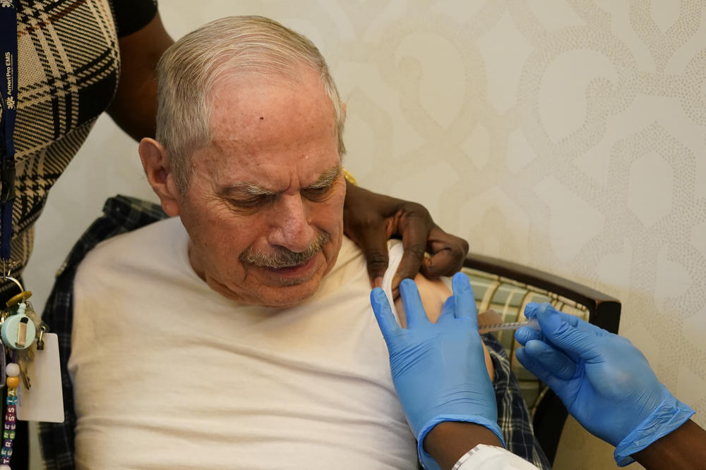 A resident of Monarch Villa memory care facility gets vaccinated with the Pfizer COVID-19 vaccine Monday, Jan. 11, 2021, in Stockbridge, Ga.
