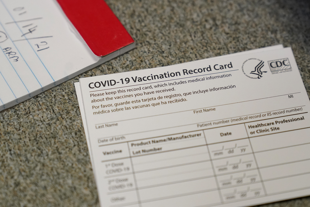 A COVID-19 vaccination record card is shown at Seton Medical Center during the coronavirus pandemic in Daly City, Calif., Thursday, Dec. 24, 2020.