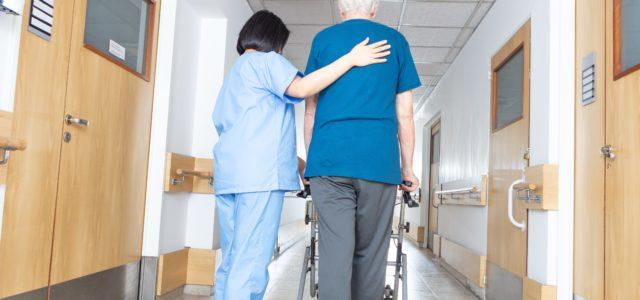 Nurse with patient in nursing home