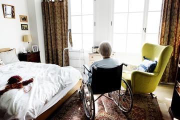 Elderly person in room at nursing home