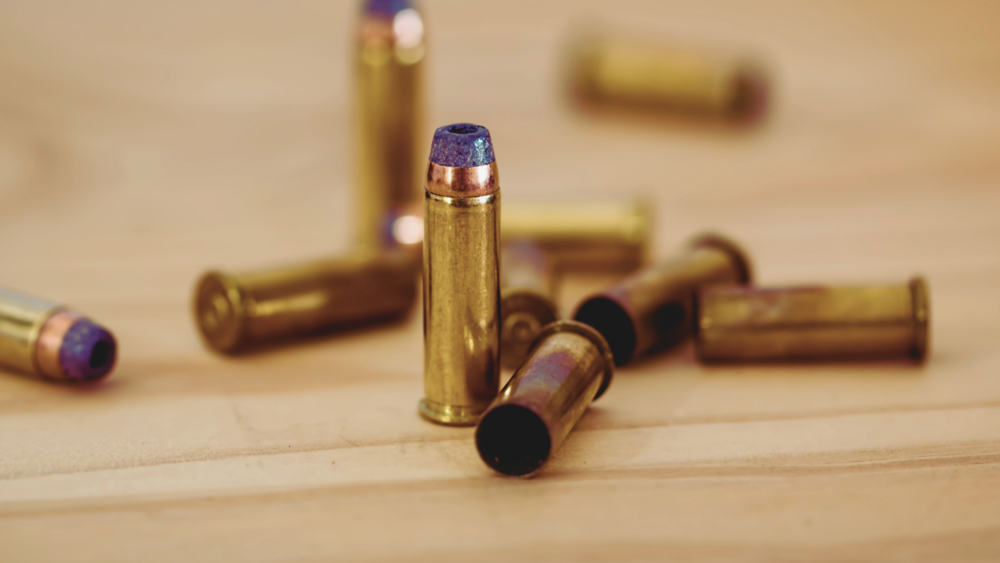 A group of bullets on a table.