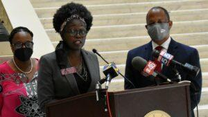Rep. Jasmine Clark called on Gov. Brian Kemp to let universities make their own mask rules at a Capitol press conference Monday.