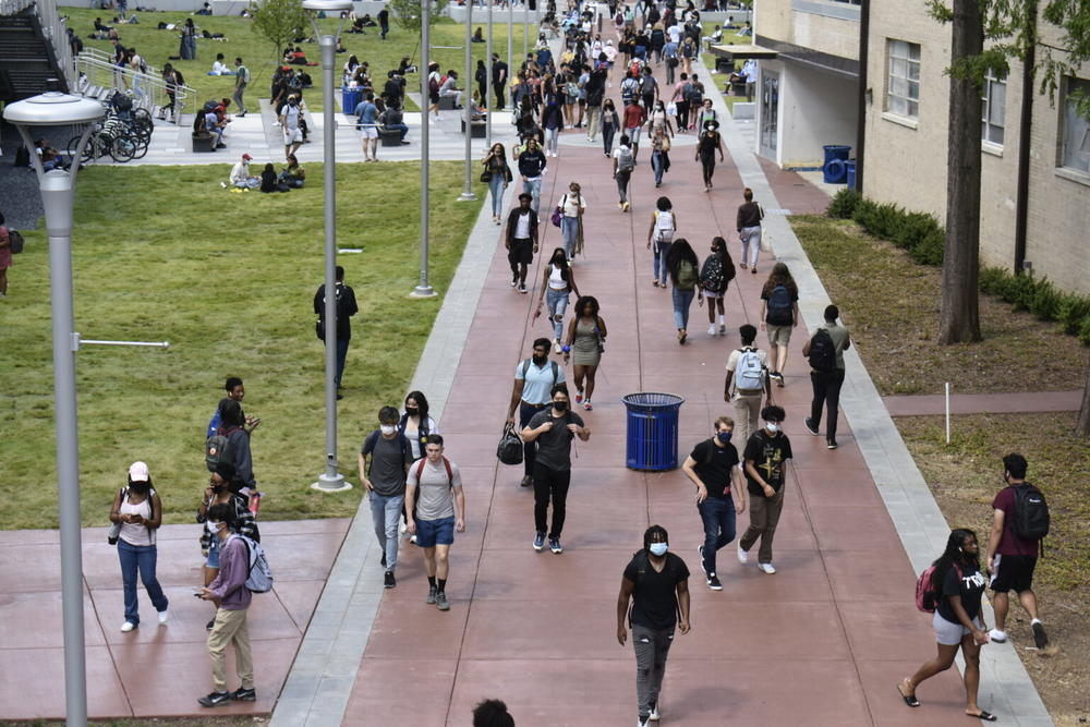 Georgia State University students walk the campus Monday. Some professors are hoping to mandate masks for these students inside campus buildings.