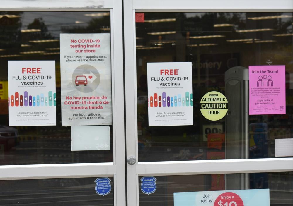 Signs outside a CVS Pharmacy in Cherokee County advertise free flu and COVID-19 vaccines. Health care experts hope flu shots along with masks and social distancing will help keep the coming flu season mild.