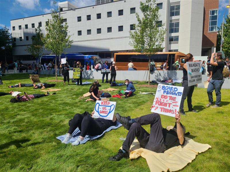 """Staff and faculty at Georgia State University participate in a """"die-in"""" protest Sept. 9, 2021, demanding more COVID-19 safety measures on campus."""