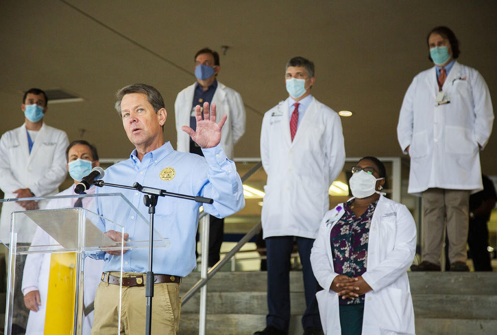 Gov. Brian Kemp with doctors from the Medical Center at Atrium Health in Macon in 2020.