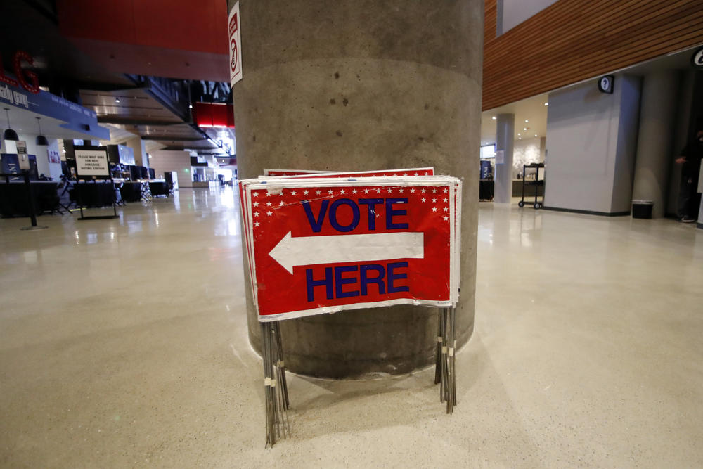 Election signs are stored at State Farm Arena, home of the NBA's Atlanta Hawks basketball team, Friday, July 17, 2020, in Atlanta.