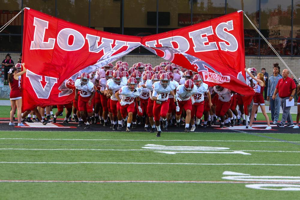 Lowndes Football Team breaks through banner