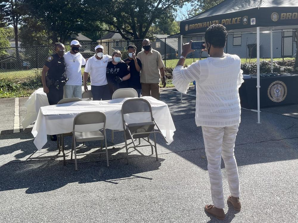 Janice Duncan captures a photo of law enforcement and community members at the Faith and Food Trucks event.