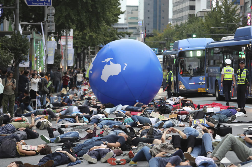 In this Saturday, Sept. 21, 2019 file photo, environmental activists stage a rally demanding action in stopping the climate crisis in Seoul, South Korea. The world's younger generations have become a vocal force in the debate over global warming.