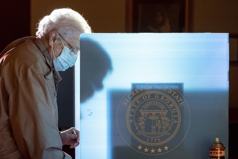 In this Jan. 5, 2021, file photo, Helen Thomason marks her ballot at the Lawrenceville Road United Methodist Church in Tucker, Ga. during the Senate runoff election