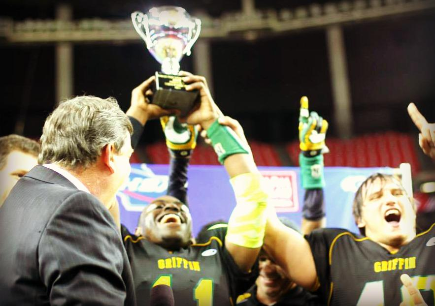 The Griffin Bears hoist the AAAA state championship trophy.