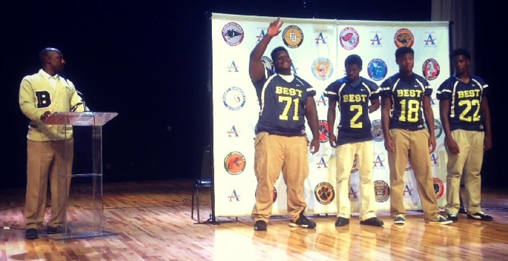 Head Coach Joshua Moore introduces senior defensive tackle/offensive guard Tyler Gibson at APS Media Day.