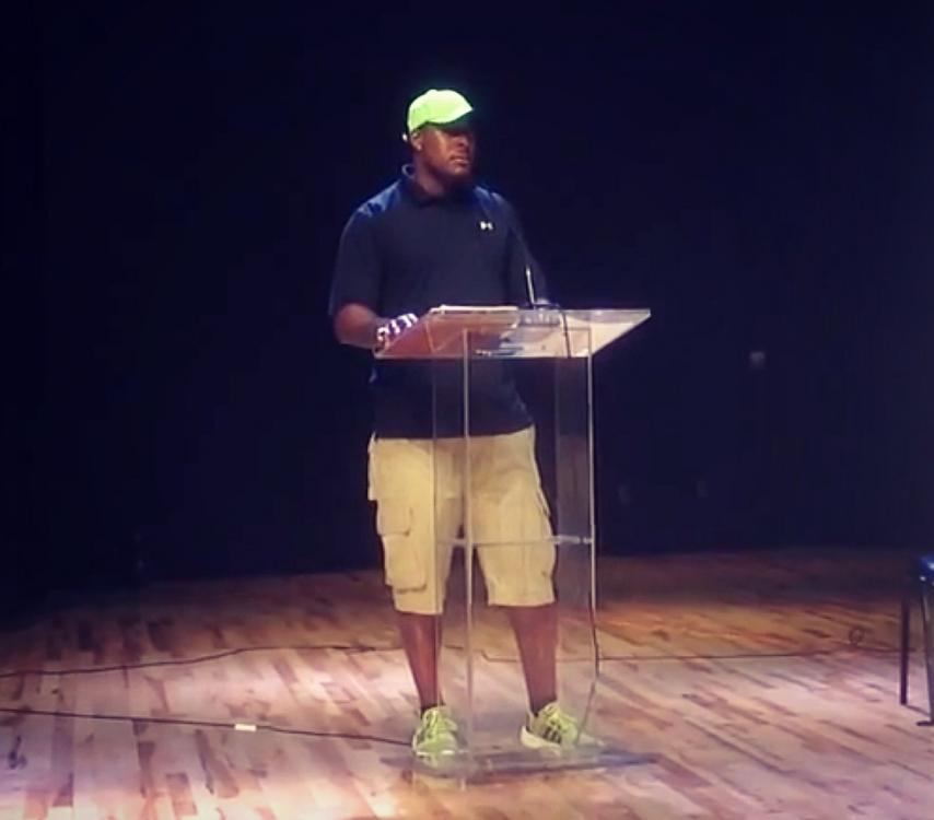 Former Frederick Douglass HS cornerback Ahmad Carroll serves as the keynote speaker at Atlanta Public Schools '14 media day.