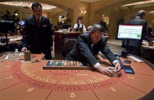Baccarat table at the MGM Grand Hotel and Casino in Las Vegas. MGM Resorts International, which owns the MGM Grand, will speak before Georgia lawmakers this week. (AP Photo/Julie Jacobson)