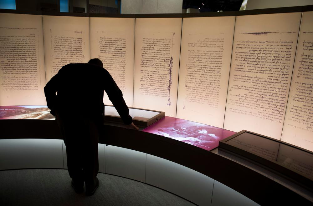 Visitors look at an exhibit about the Dead Sea Scrolls during a media preview of the Museum of the Bible in 2017. In March of this year, the museum announced that one of its prized possessions — purported fragments of the Dead Sea Scrolls — had been found to be modern forgeries.