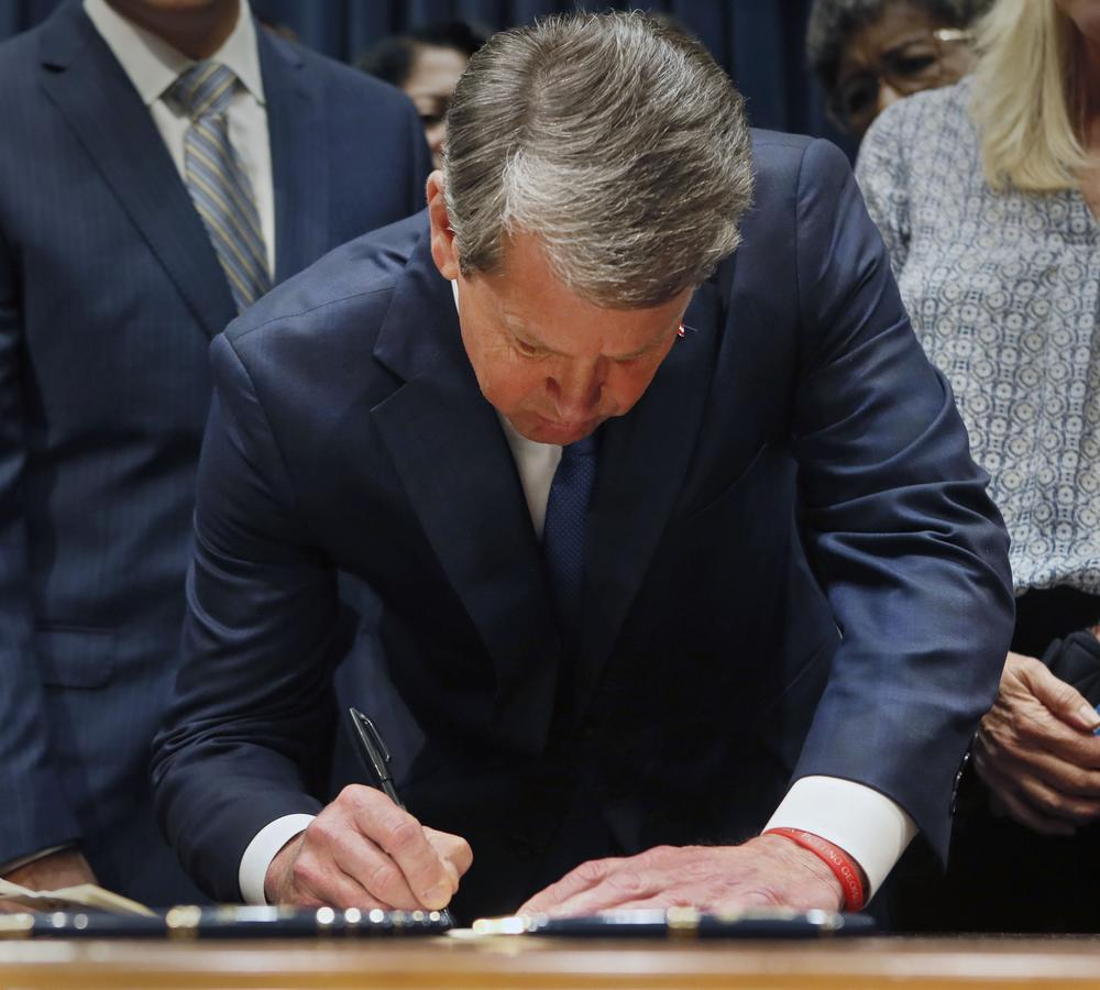 "Surrounded by supporters of the bill, Gov. Brian Kemp signed HB 481, the ""heartbeat bill,"" setting the stage for a legal battle as the state attempts to outlaw most abortions after about six weeks of pregnancy."