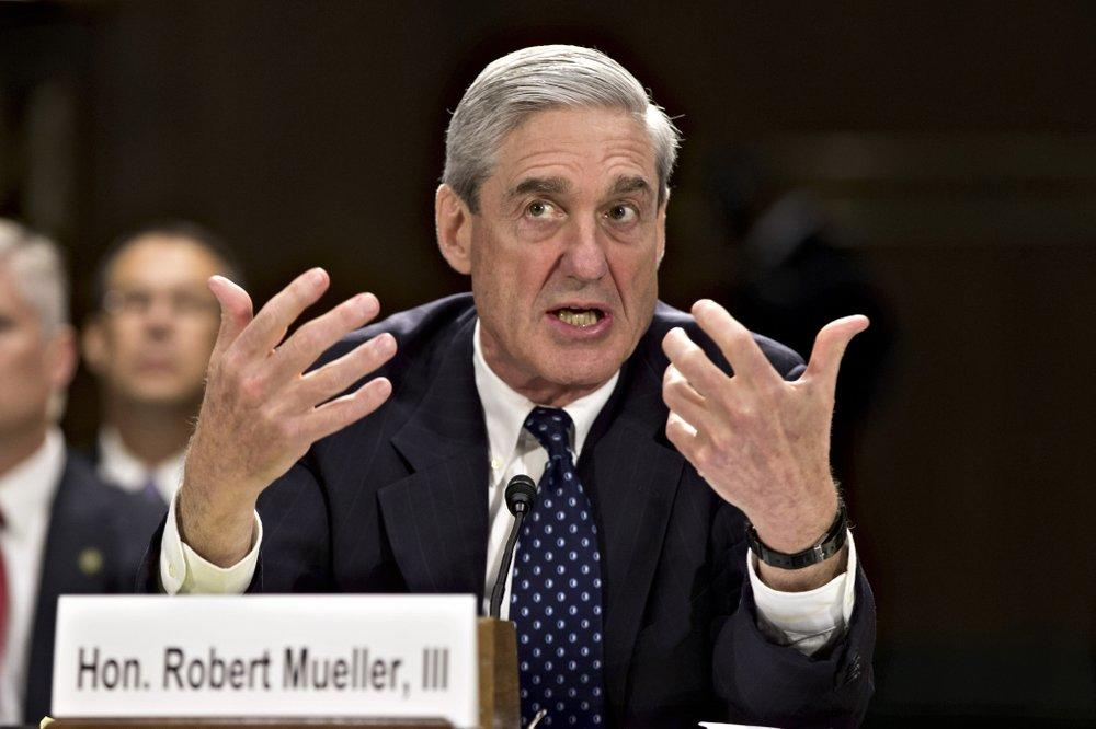 In this June 19, 2013, file photo, then-FBI Director Robert Mueller testifies on Capitol Hill in Washington. When special counsel Mueller testifies before Congress it will be a moment many have been waiting for, but it comes with risk for Democrats.