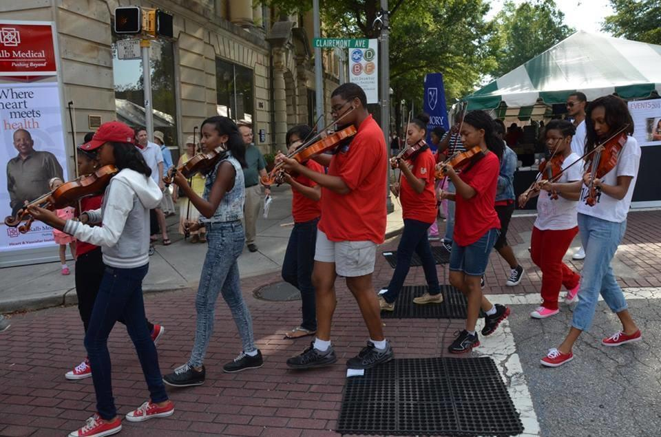 Music in the Park embraces artists and musicians to showcase their talents by parading the streets.