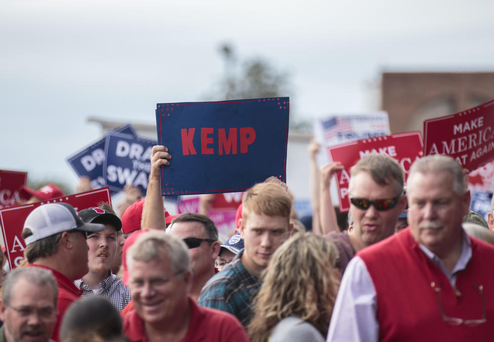A Kemp sign in a sea of Trump signs.