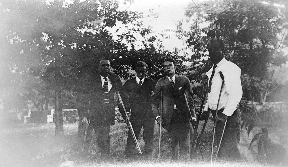 Franklin D. Roosevelt (right) with three other polio patients in Warm Springs, Georgia, in 1925.