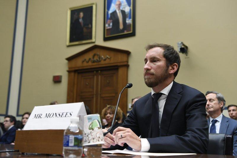 In this July 25, 2019, file photo, Juul Labs co-founder and Chief Product Officer James Monsees testifies before a House Oversight and Government Reform subcommittee on Capitol Hill in Washington, during a hearing on the youth nicotine epidemic. Vaping giant Juul Labs has donated thousands of dollars to court state attorneys general. But the lobbying strategy may be backfiring.