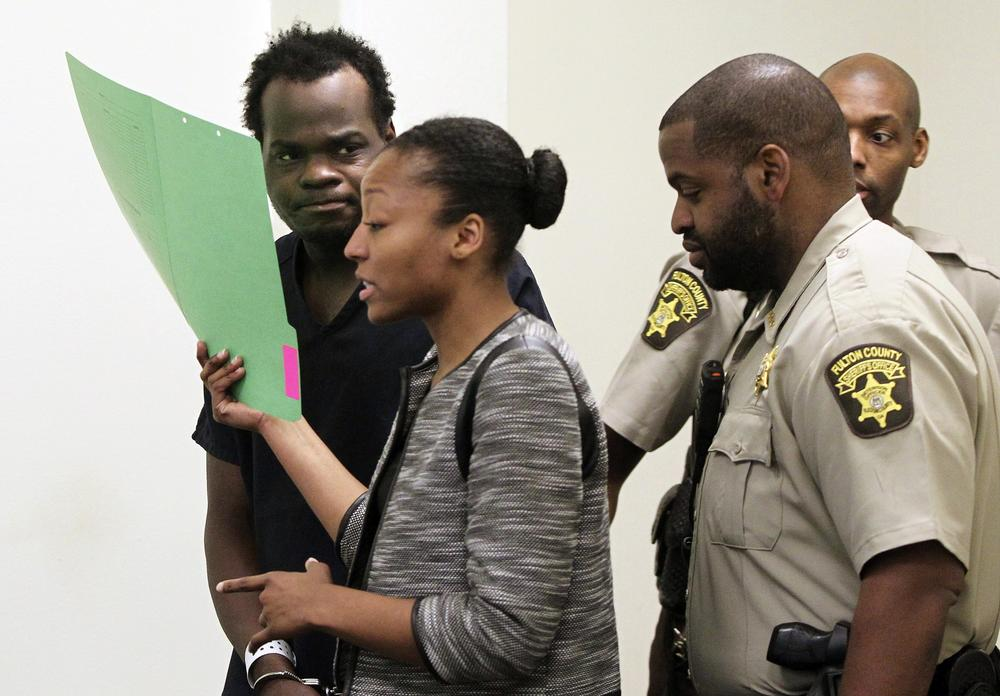 Basil Eleby is escorted by his public defender and two Fulton County Sheriff's office officers into the court room at the Fulton County Jail in Atlanta on Saturday, April 1, 2017.