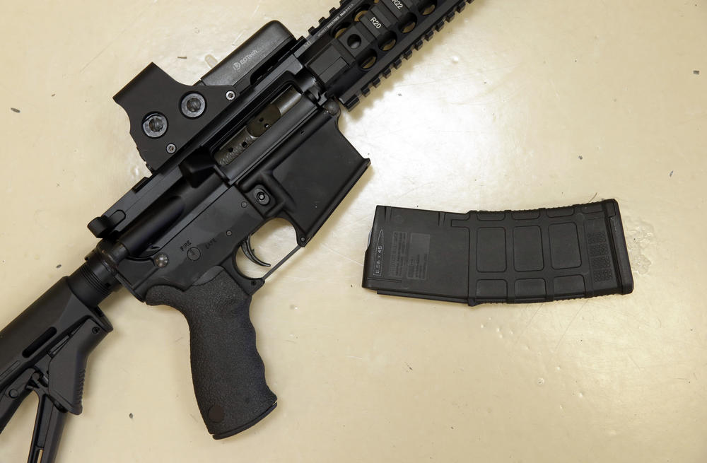 FILE - This Oct. 3, 2013 file photo shows a custom-made semi-automatic hunting rifle with a high-capacity detachable magazine is displayed at a gun store in Rocklin, Calif.
