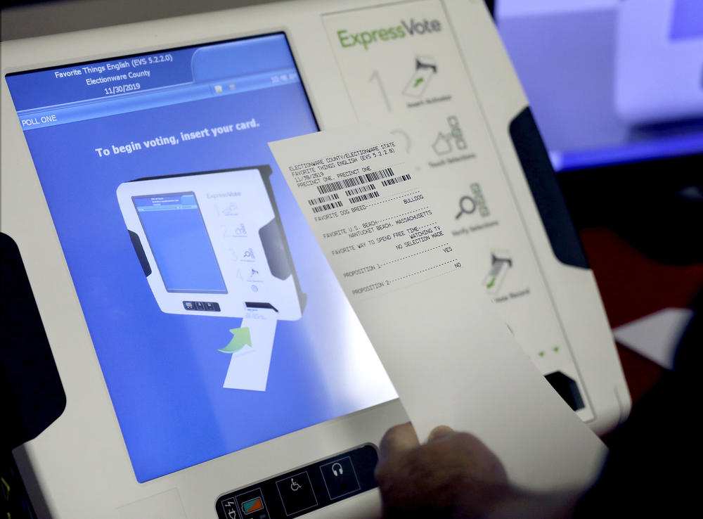 In this Thursday, Oct. 19, 2017 photo, a new voting machine which prints a paper record sits on display at a polling site in Conyers, Ga.