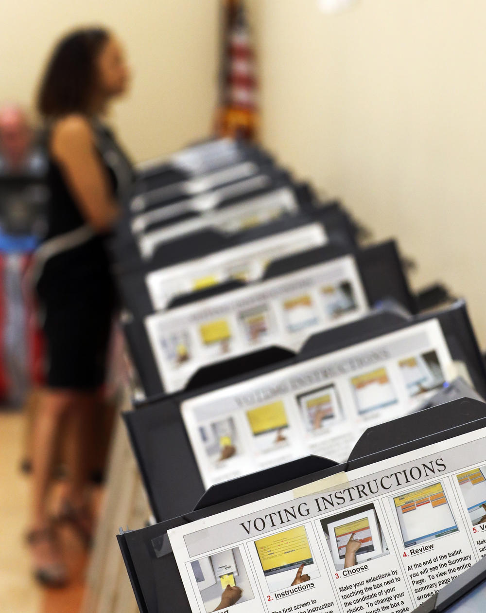In this Wednesday, May 9, 2018, photo, Pamela Hampton votes in Sandy Springs, Ga.