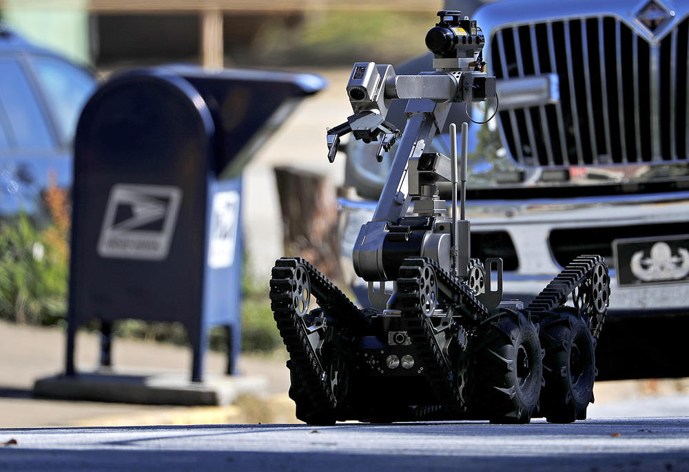 A robot exits a U.S. post office facility as law enforcement officials investigate a report that a suspicious package was found in Atlanta. The FBI said authorities recovered the suspicious package that was addressed to the cable network CNN.