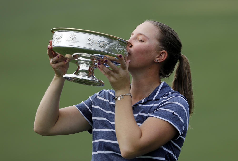 Jennifer Kupcho kisses the trophy after winning the Augusta National Women's Amateur golf tournament in Augusta, Ga., Saturday, April 6, 2019.