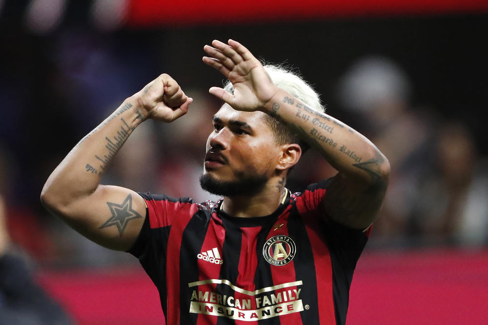Atlanta United forward Josef Martinez gestures to the crowd after the team defeated the Philadelphia Union 2-0 in an MLS soccer Eastern Conference quarterfinal Thursday, Oct. 24, 2019, in Atlanta.