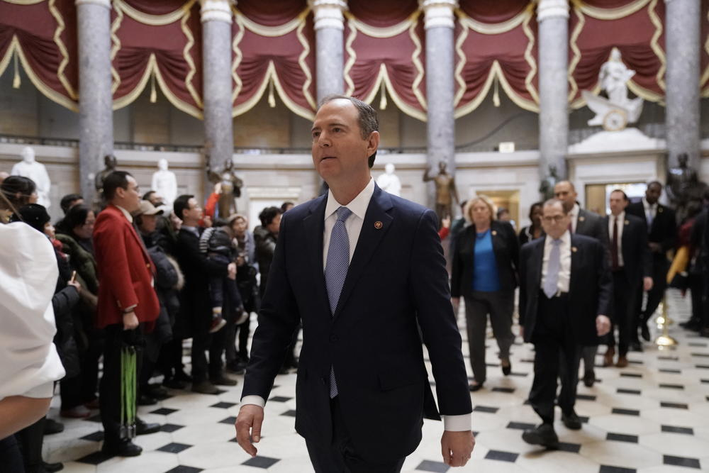 Impeachment managers, House Intelligence Committee Chairman Adam Schiff, D-Calif., front center, followed by House Judiciary Committee Chairman, Rep. Jerrold Nadler, D-N.Y., and others, walk to a press conference at the Capitol Tuesday morning.