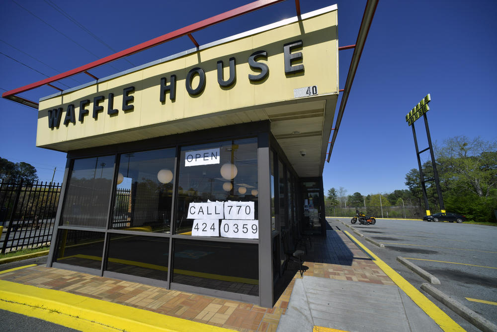 Signage is posted on the inside windown of a Waffle House restaurant, near Kennesaw State, Wednesday, March 25, 2020, in Kennesaw, Georgia. The Norcross-based chain is ready to reopen this week.