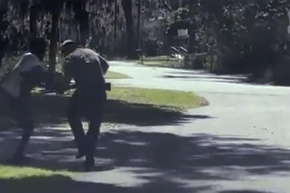 This image from video posted on Twitter Tuesday, May 5, 2020, purports to show Ahmaud Arbery, left, struggling with Travis McMichael over a shotgun on a street in a neighborhood outside Brunswick, Ga., on Feb. 23, 2020.