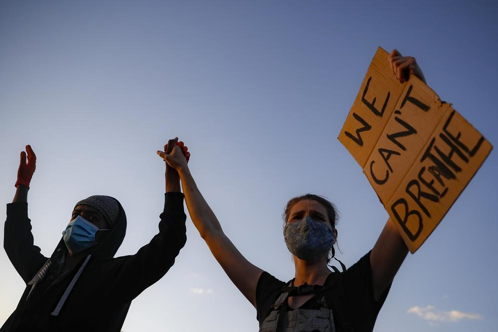 Protesters demonstrate on University Avenue while holding a
