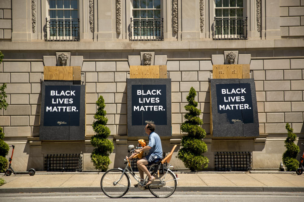 The words Black Lives Matter are painted on boarded up windows of the Hay Adams Hotel, a site of protests, near the White House in Washington.