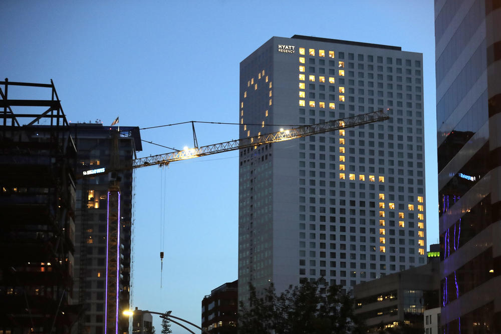 "Lit windows at the Seattle Hyatt Regency Hotel display a heart and ""BLM"" for Black Lives Matter, Thursday, June 18, 2020, in downtown Seattle."