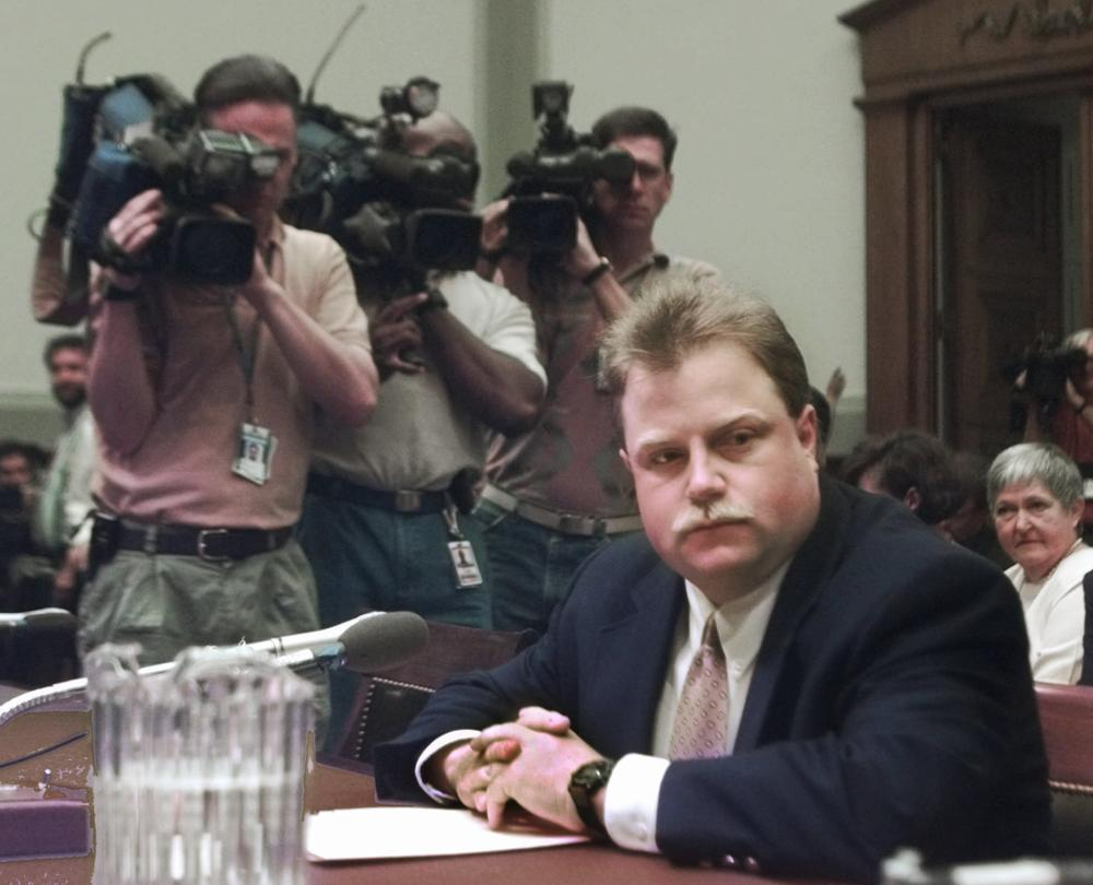 Photographers surround Richard Jewell prior to testifying before a House Judiciary subcommittee hearing on the 1996 Olympic bombing in Atlanta, July 30, 1997.