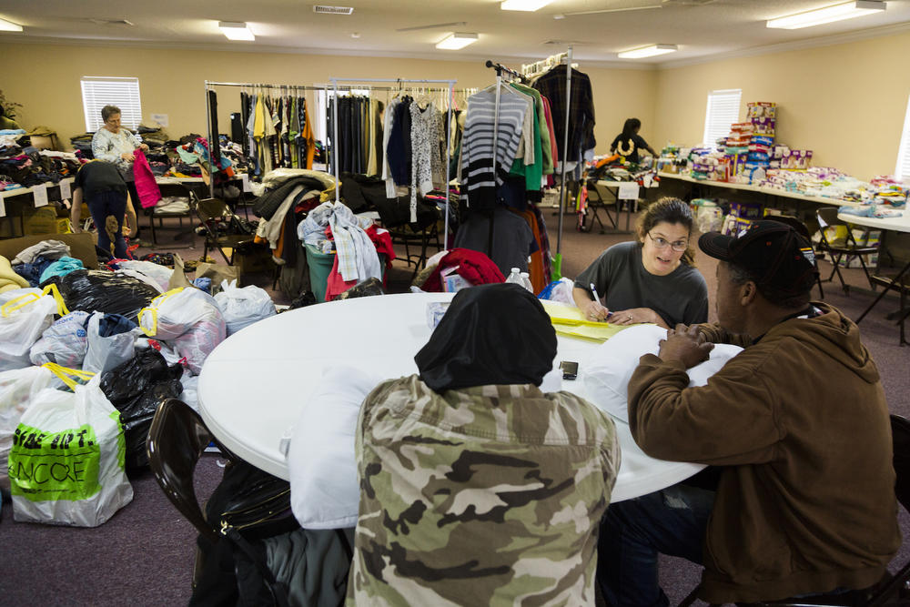 Caption/Description: First Assembly Church of God in Adel was the hub for storm relief activity as people made homeless by the weekend's storm looked for clothes, food and shelter.