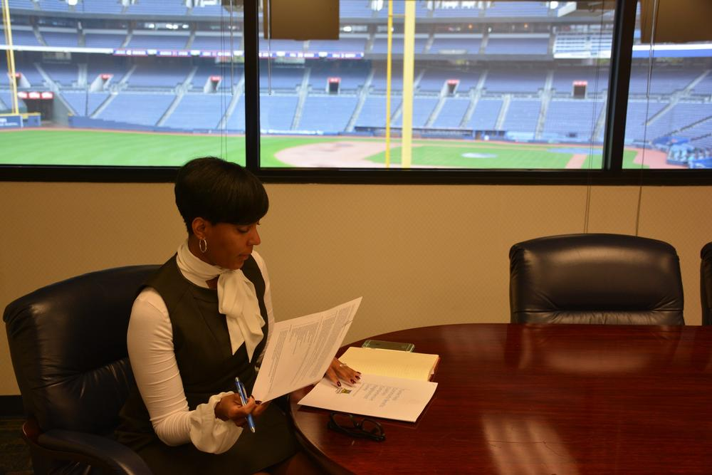 Keisha Lance Bottoms looking over paperwork in her office in Turner Field.