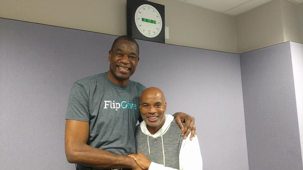 Former Atlanta Hawks player Dikembe Mutombo (l) with guest host Tony Harris (r)