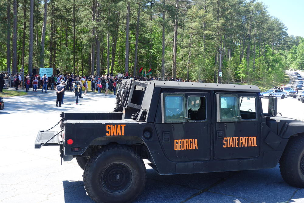 SWAT teams hold back counter-protesters.