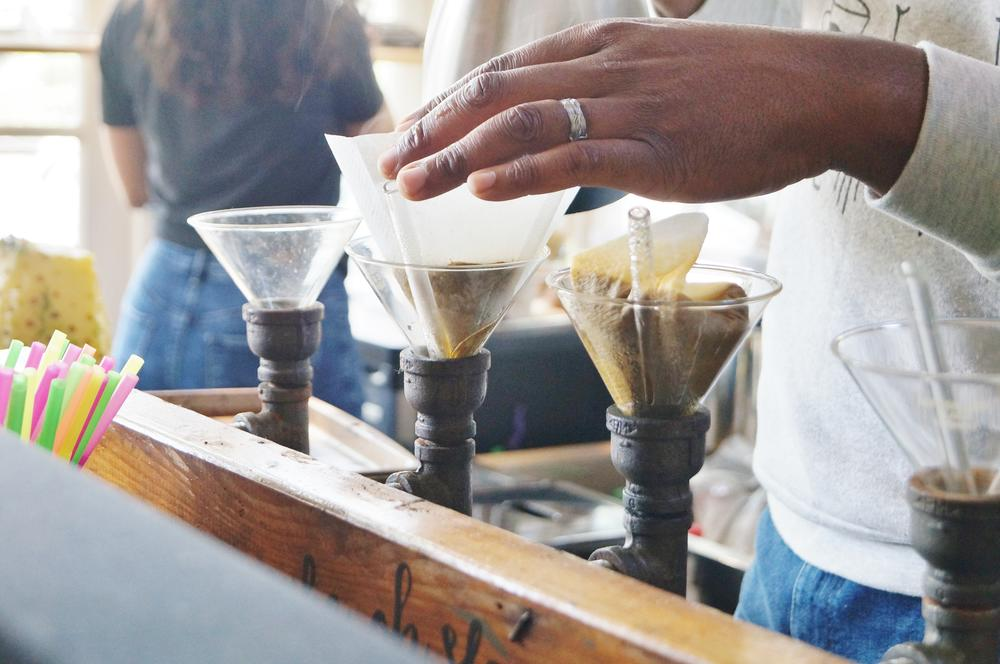 Daniel Brown makes coffee at Gilly Brew Bar in Stone Mountain.