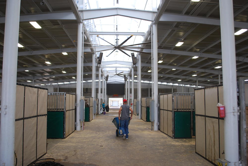 A horse owner hauls shavings at the Georgia National Fairgrounds.