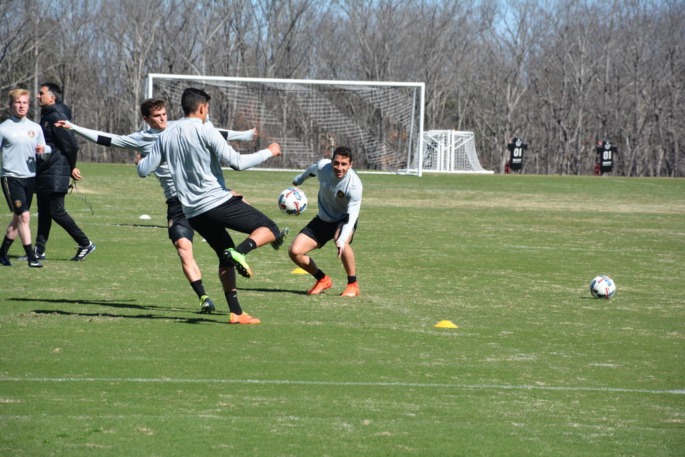 Members of Atlanta United FC practice at the Falcons training facility in Flowery Branch.