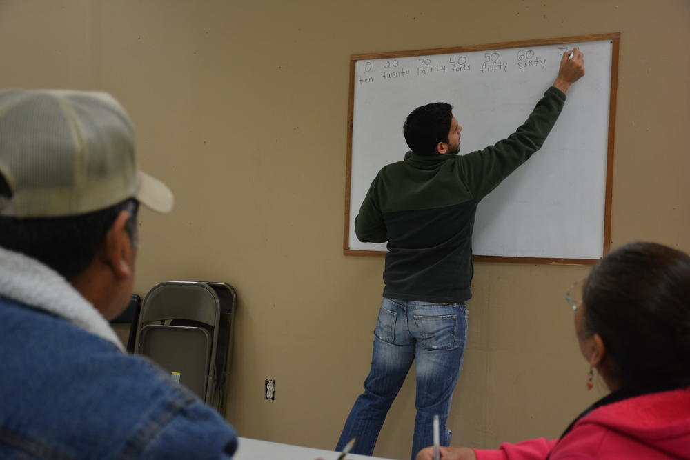 Ramon Peña teaching members of Dalton's Hispanic community how to count in English. He said Whitfield County's participation in Immigrations and Customs Enforcement's 287(g) has led to confusion and fear.