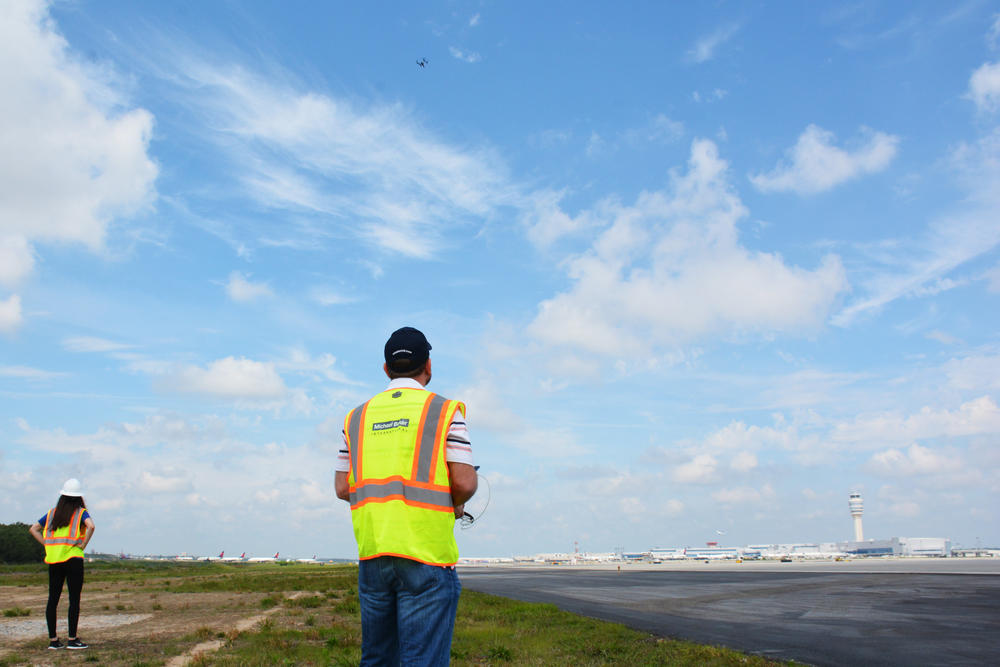 Katie Eleam acts as a spotter for pilot Jim Duguay, who has to fly the drone manually in the busy airspace around Hartsfield-Jackson.